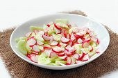pic of sackcloth  - Simple easy spring rustic salad of radish and cucumber in plate at sackcloth on white background - JPG