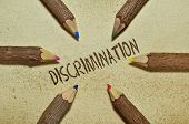 stock photo of racial discrimination  - Conceptual image with pencils on vintage background about discrimination - JPG