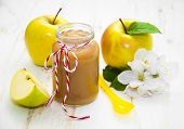 pic of apple blossom  - Baby apple puree in a jar with apples and blossom on wooden white background - JPG