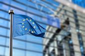 picture of european  - European Union flags in front of the blurred European Parliament in Brussels - JPG