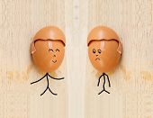 stock photo of human egg  - two happy friend with painted egg on wood - JPG