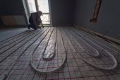 image of convection  - pipefitter installing system of heating - JPG