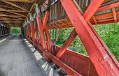 picture of covered bridge  - The supporting timber trusses are seen on the interior of Indiana - JPG