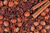 picture of cinnamon sticks  - Coffee chocolate star anise hazelnuts and cinnamon sticks background - JPG