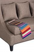 foto of no clothes  - Stylish couch and cushions in beige basket weave cloth and cloth colour samples for home and office interior - JPG