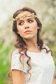 stock photo of tiara  - Beautiful Girl with golden tiara on her head in spring garden - JPG