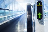 stock photo of escalator  - Escalator walkway with Arrow signage at the Airport - JPG