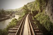 picture of train track  - Train track with river and mountain view railway in Thailand - JPG