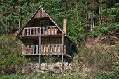 picture of abandoned house  - Abandoned wooden house in small village in sunny day - JPG