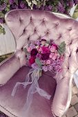 pic of purple rose  - a silk purple chair lies a bouquet of lilacs and roses  - JPG