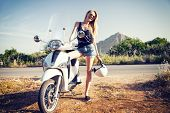 foto of scooter  - Beautiful happy blonde girl posing with scooter - JPG