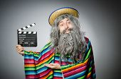 stock photo of hairy  - Funny hairy mexican with movie clapper - JPG