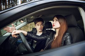 picture of independent woman  - quarrel in the car - JPG