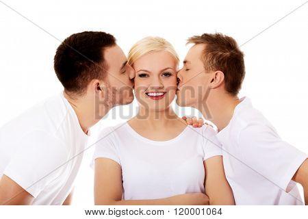 Two guys kissing friend woman cheeks