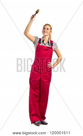 Young Happy Woman In Red Jumpsuit With Paint Brush