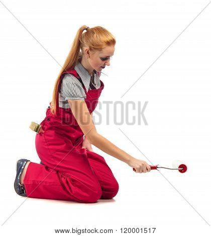 Young Happy Woman In Red Jumpsuit With Painting Tools