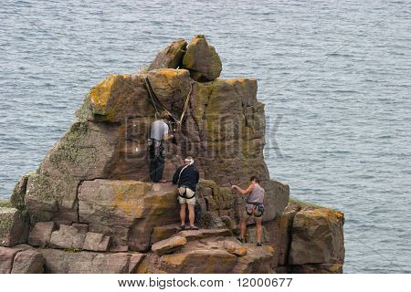 Climbers at the summit of the 'Old Man of Stoer'