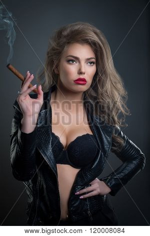 Sexy Young Woman With Sigar On Dark Background Studio Shot Photo