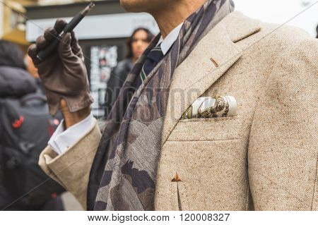 MILAN ITALY - FEBRUARY 25: Detail of a fashionable man posing outside Luisa Beccaria fashion show building for Milan Women's Fashion Week on FEBRUARY 25, 2016 in Milan.