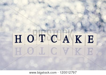 Written word of tiles with letters - hotcake