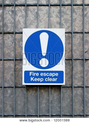 Fire Escape sign on galvanized door