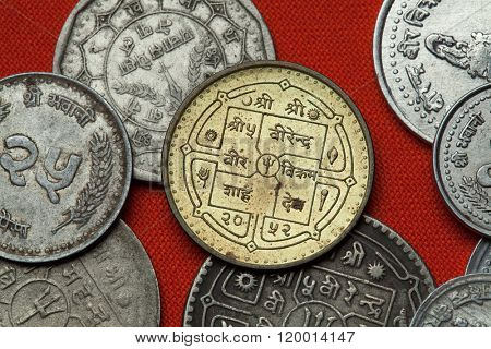 Coins of Nepal. Hindu trishul depicted in the Nepalese rupee coin.