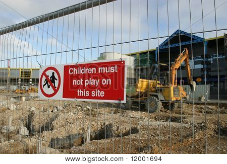 Sign on Construction Site Barrier