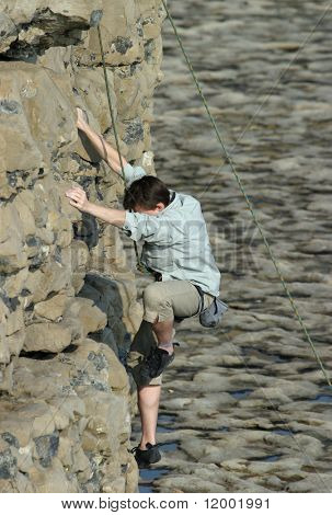 Climber on cliff face
