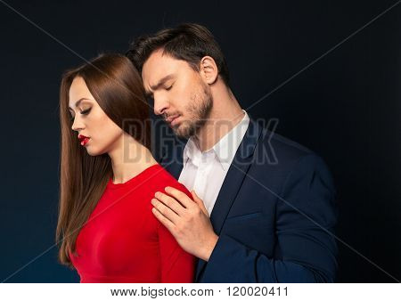 Handsome man embracing attractive woman