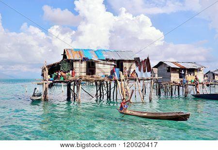 Bajau Laut kid on a boat