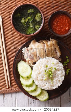 Hainanese Chicken Rice, Chilli Sauce And Bouillon Close-up. Vertical Top View