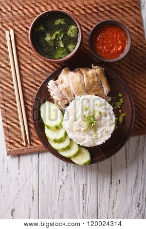 Hainanese Chicken Rice, Chilli Sauce And Bouillon. Vertical Top View