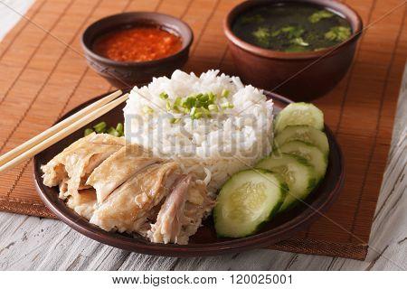 Hainanese Chicken Rice Close-up, Chili Sauce And Broth. Horizontal