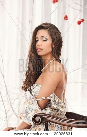 Girl On A Vintage Dress Possing With Stick Of Apple Undressing