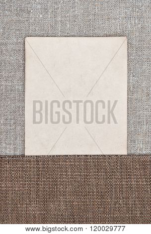 Vintage Background With Old Paper On Rude Fabric And Burlap