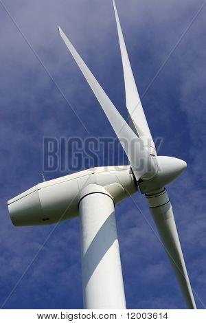 Detail of wind turbine against a deep blue sky
