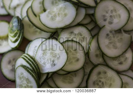 Picture shot from above down in bowl of sliced cucumbers.