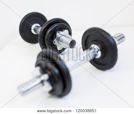 A pair of dumbbells on a white background.