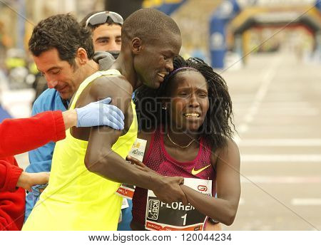 BARCELONA - FEB, 15: Florence Kiplagat(R) with Abel Kirui(L) after to break half Marathon world record during Barcelona Half Marathon in Barcelona on February 15, 2015 in Barcelona, Spain.