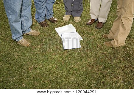 Five students stood outdoors