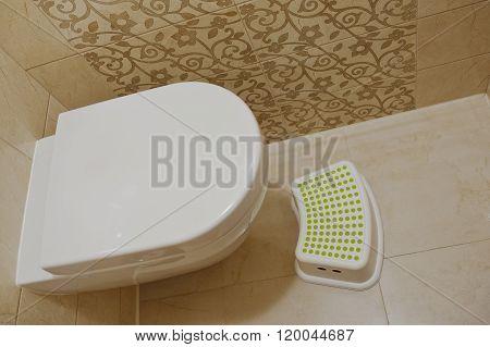 Modern White Toilet With Children Footrest