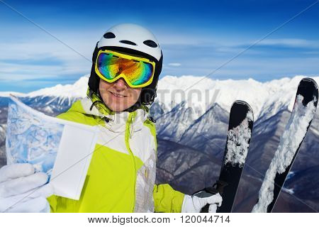 Woman with ski track map on the mountain