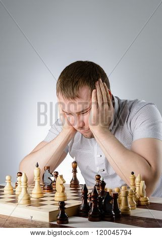 The Man Is Thinking About A Game Of Chess