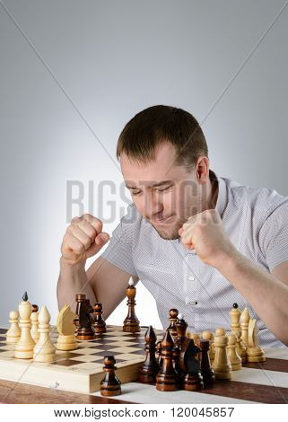 The Man Clenched His Hands Into A Fist On Chess