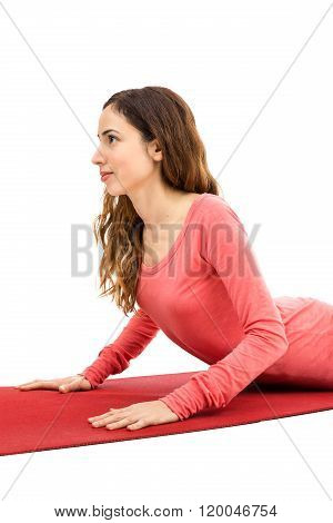 Attractive Woman Doing Cobra Pose In Yoga