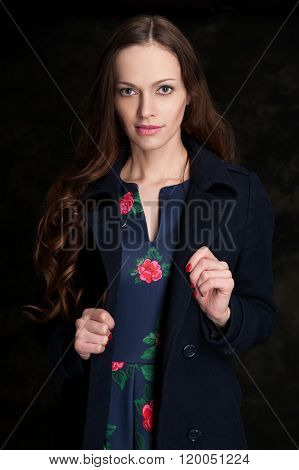 Beautiful Young Woman In A Dress. Studio, Black Background.