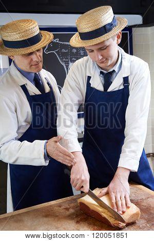 Butcher Teaching Apprentice How To Prepare Sirloin Steak