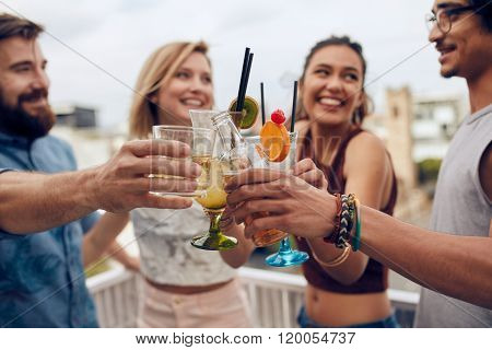 Friends Toasting Cocktails At A Party