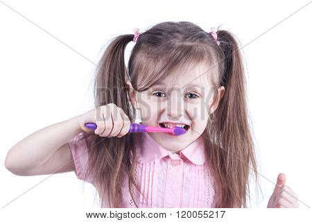 fun child cleaning teeth isolated on white background