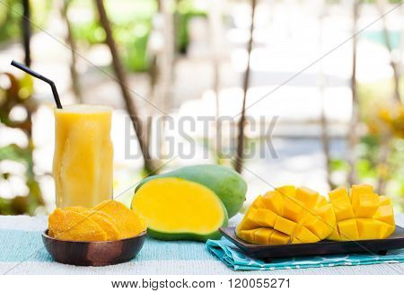 Fresh and dried mango fruit with smoothie juice Copy space